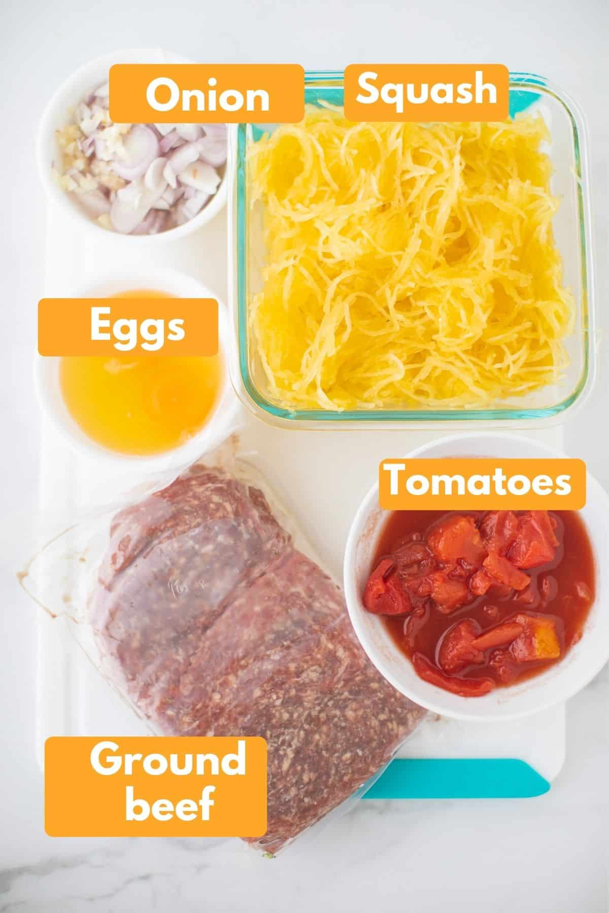 labeled photo with ingredients for spaghetti squash pizza casserole