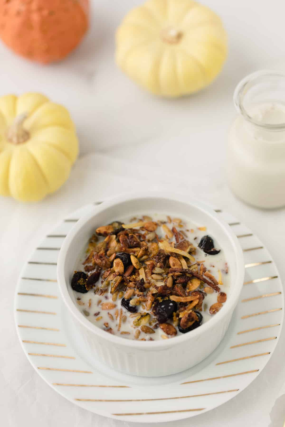 pumpkin granola served in a bowl with almond milk