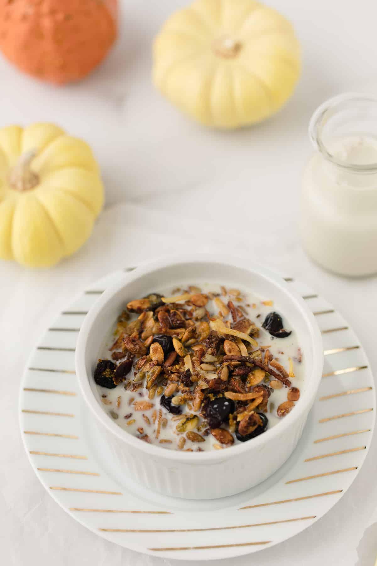 pumpkin granola served in a bowl with almond milk