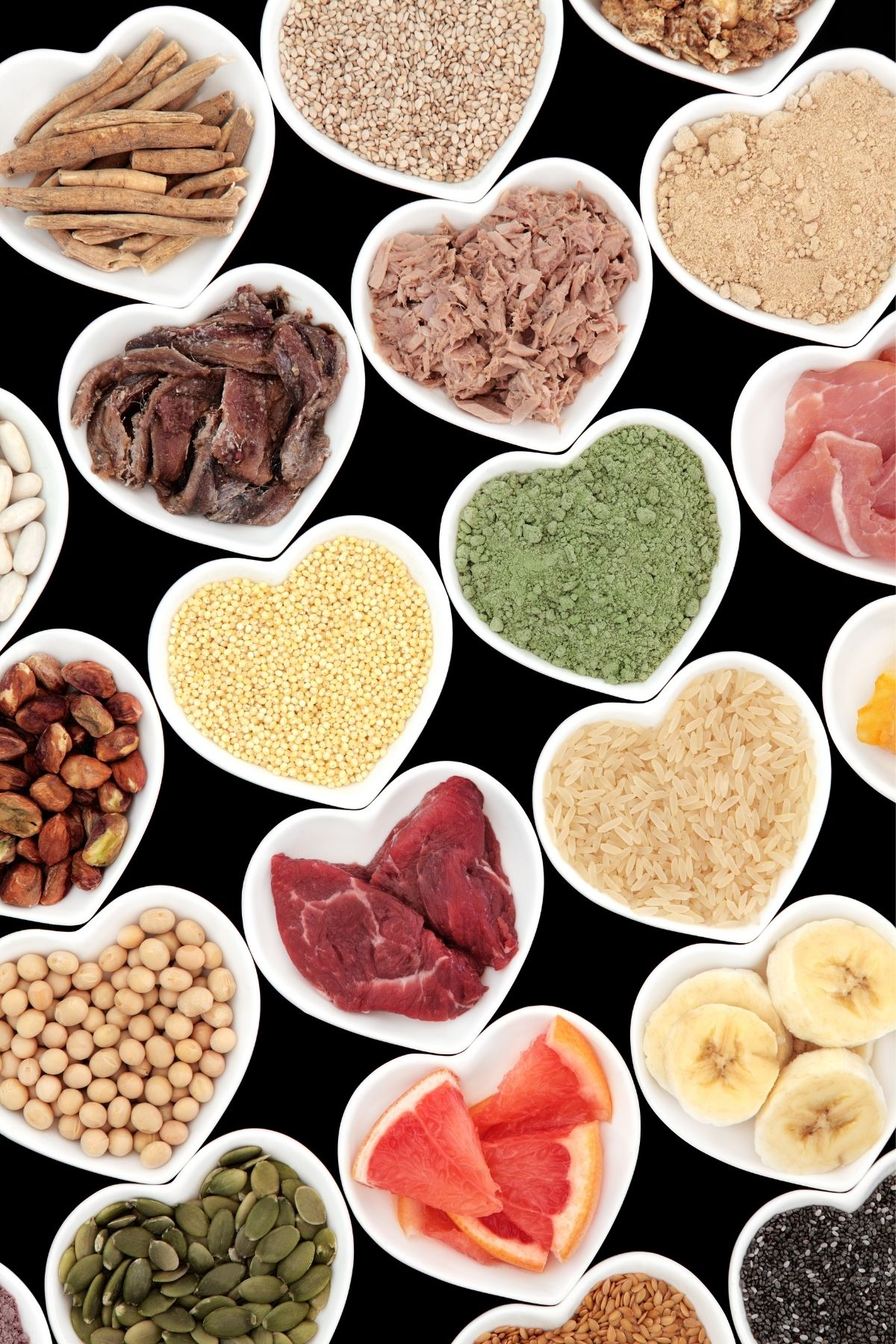 selection of healthy foods in heart shaped bowls