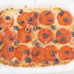 pizza casserole in a white baking dish ready to be served