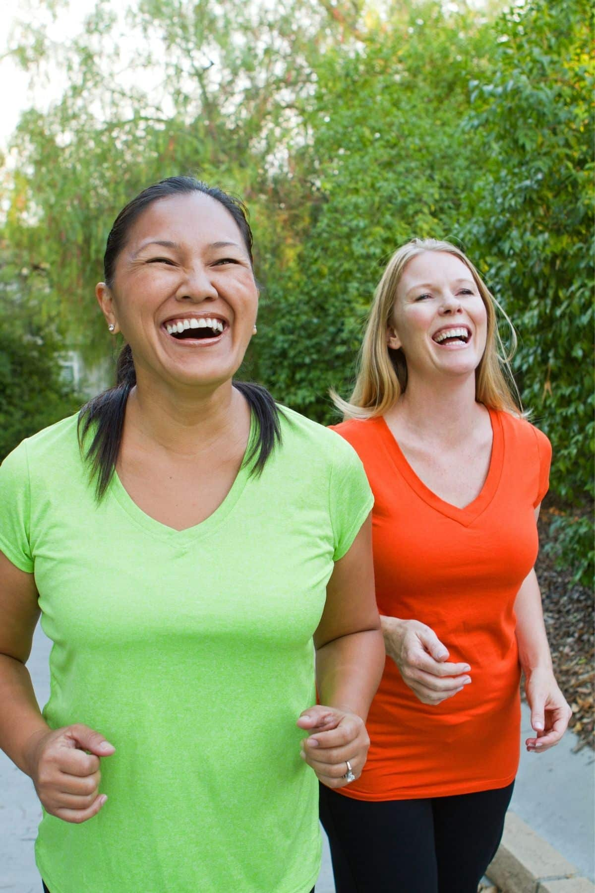 two women exercising and laughing together
