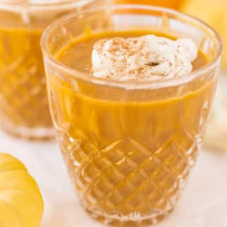 pumpkin pudding in a pretty crystal glass ready to be eaten