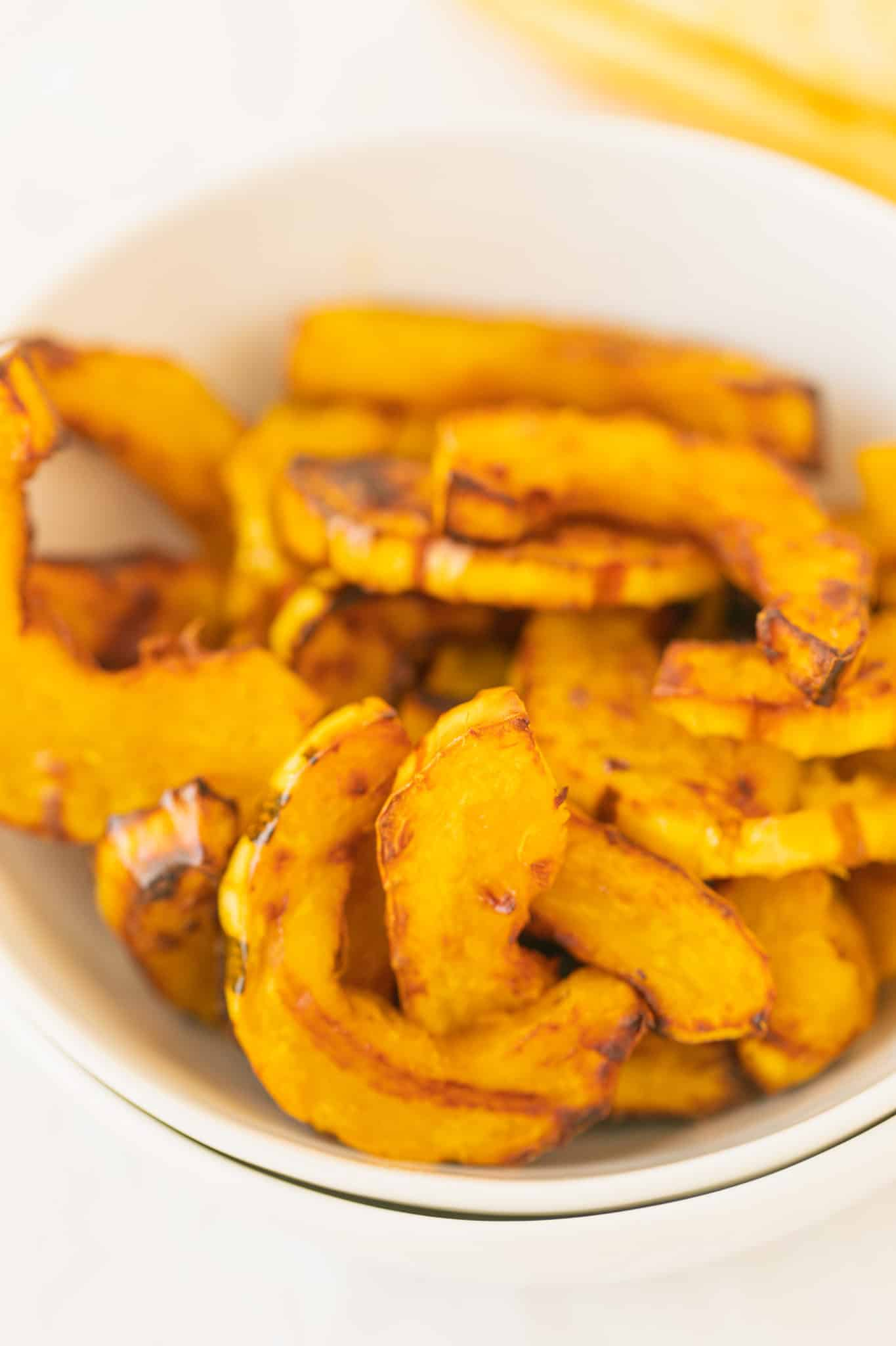 cooked air fryer delicata squash served in a white bowl