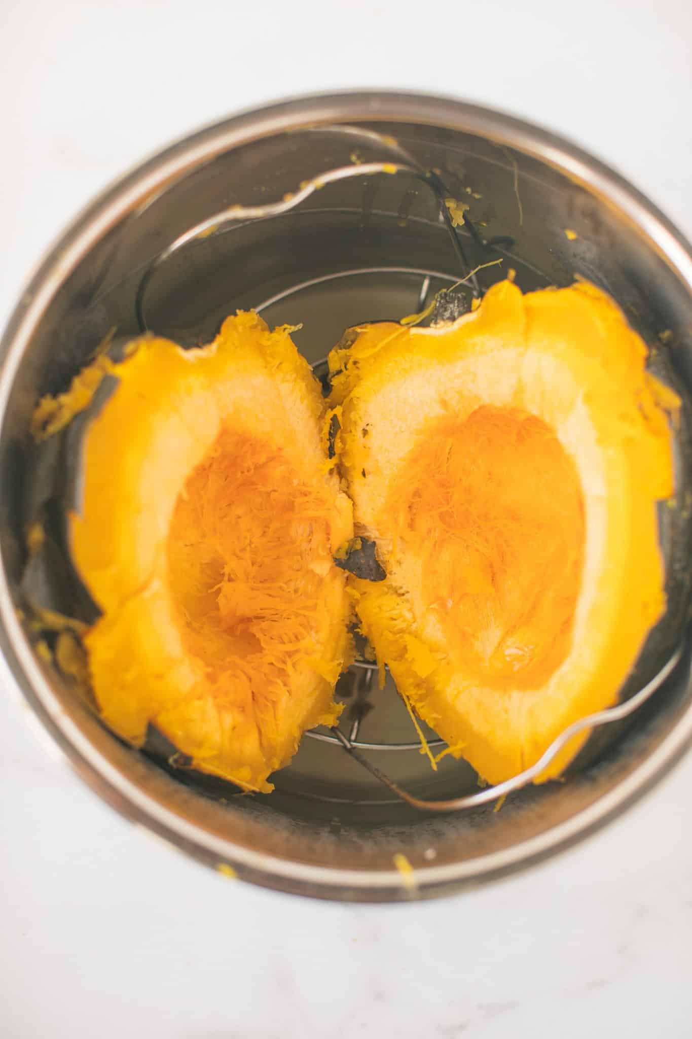 acorn squash cut in half in an instant pot pressure cooker