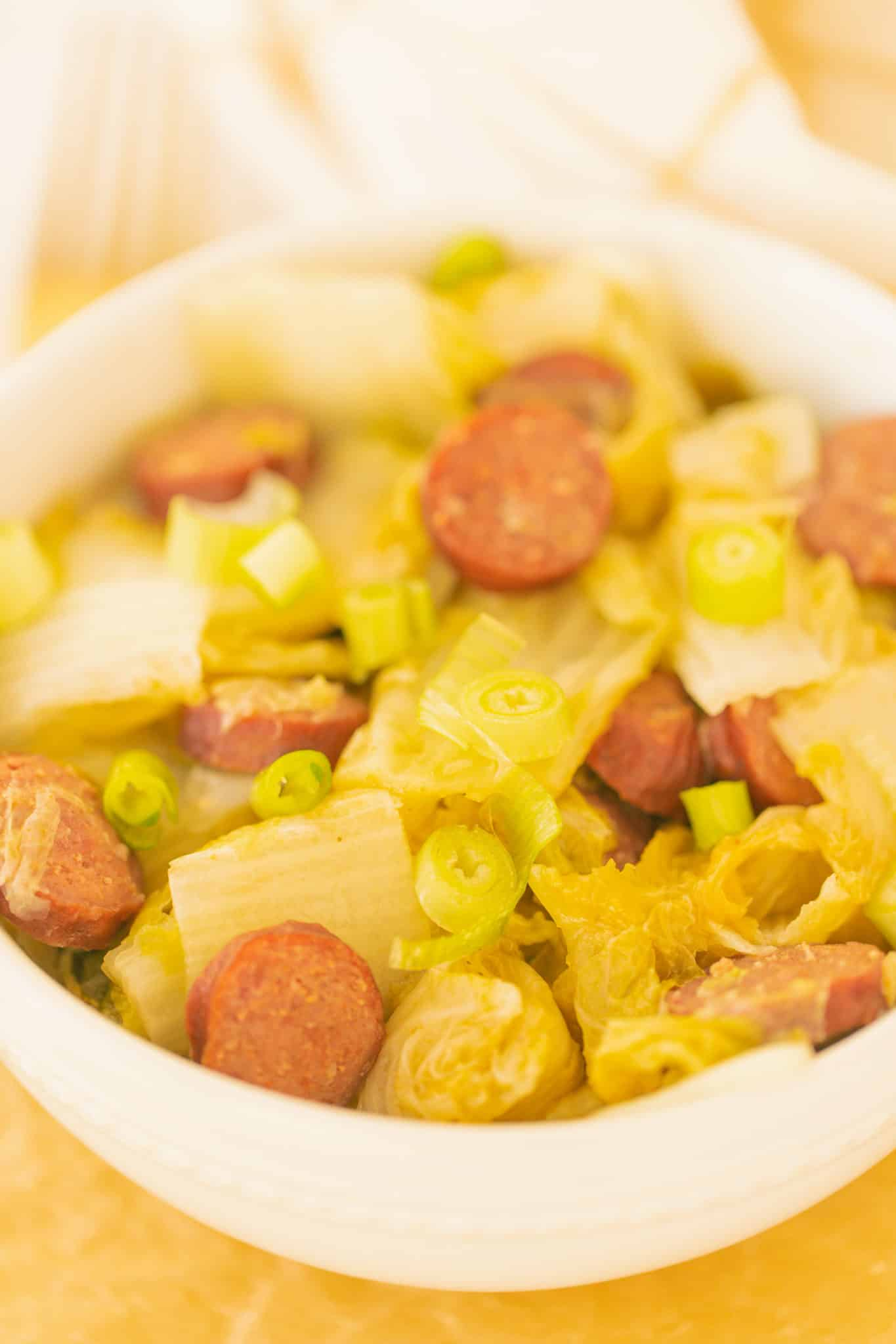 bowl of cooked cabbage and sausage