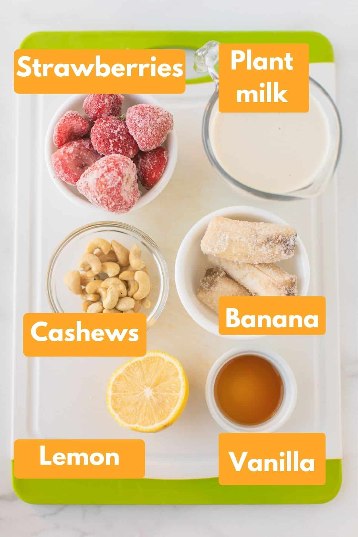 labeled photo with ingredients for strawberry cheesecake smoothie