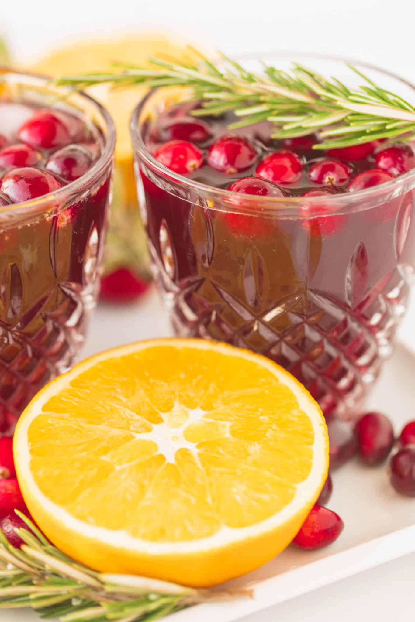 cranberry cocktail for the holidays served with fresh oranges