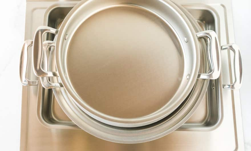 stack of stainless steel cookware on a countertop