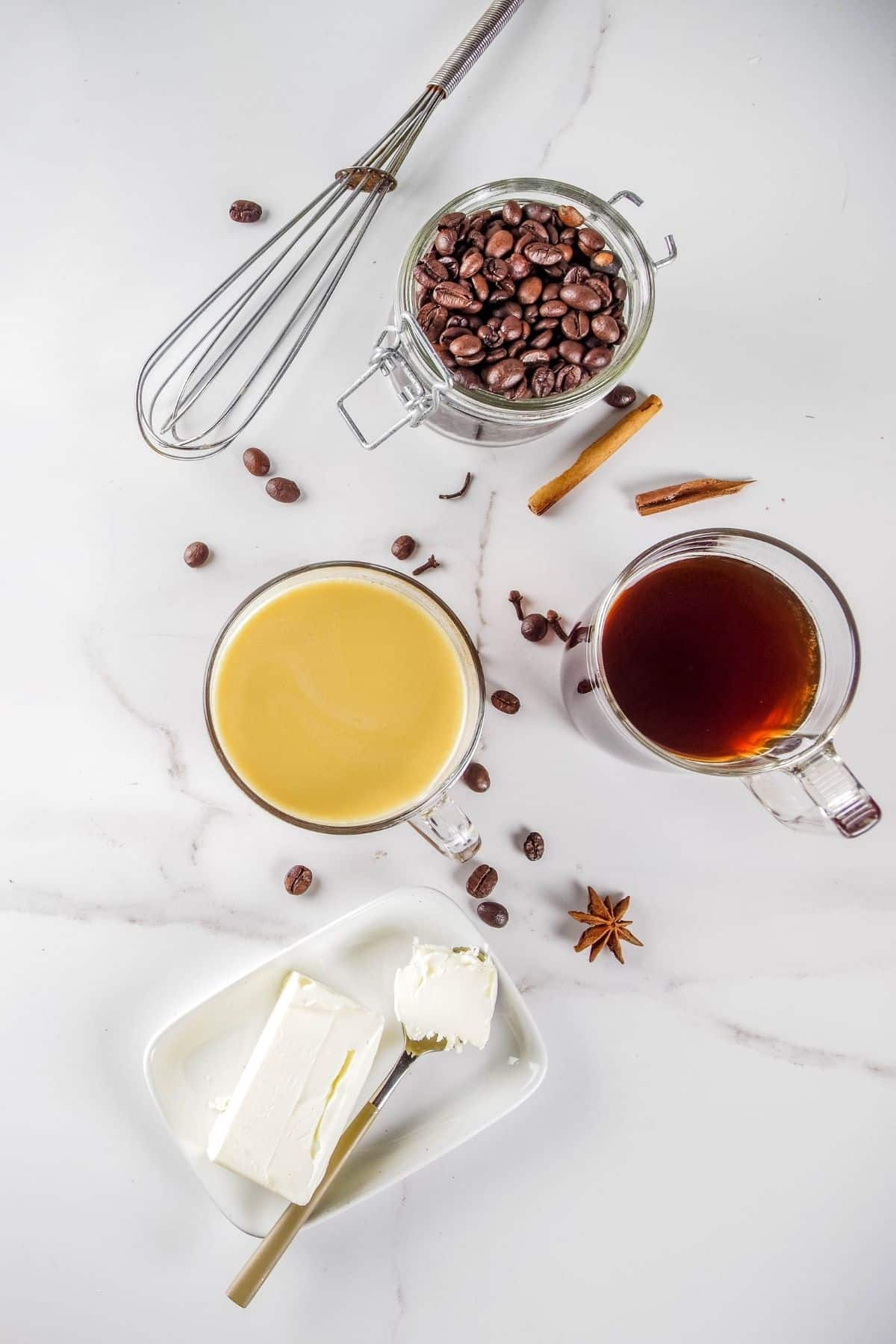 ingredients for butter coffee on a marble kitchen countertop