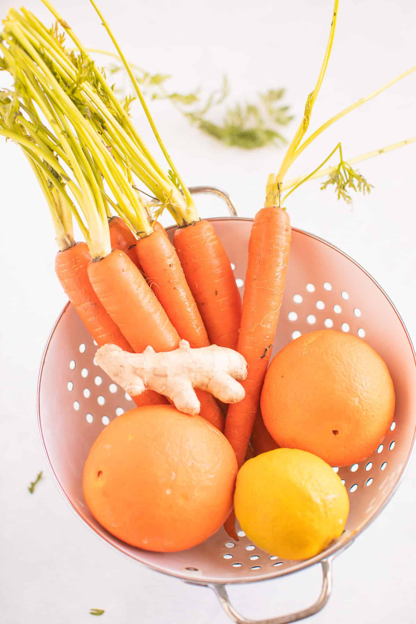 carrot juice ingredients in a colander ready to be juiced