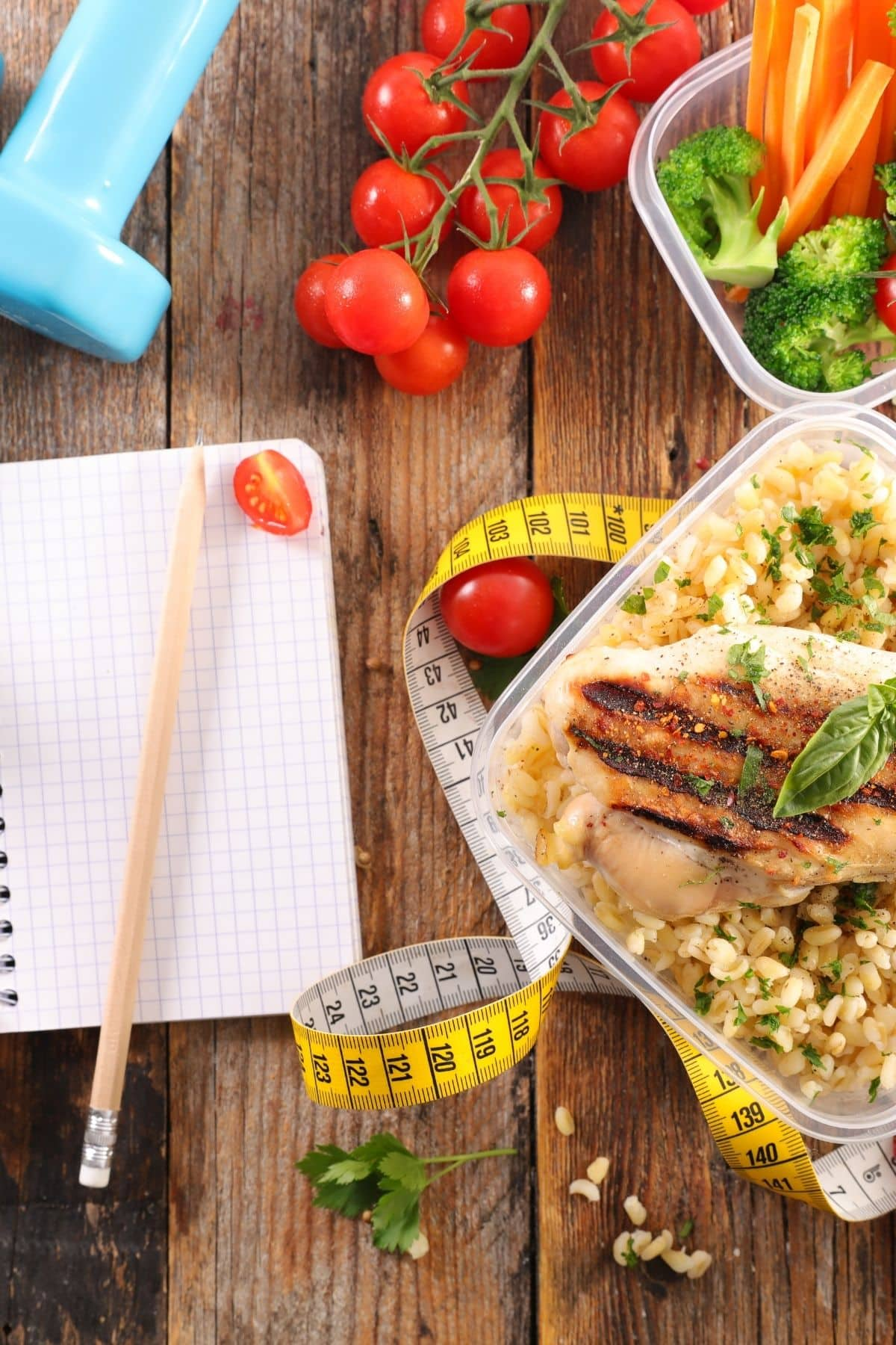 diet journal and healthy food on a table