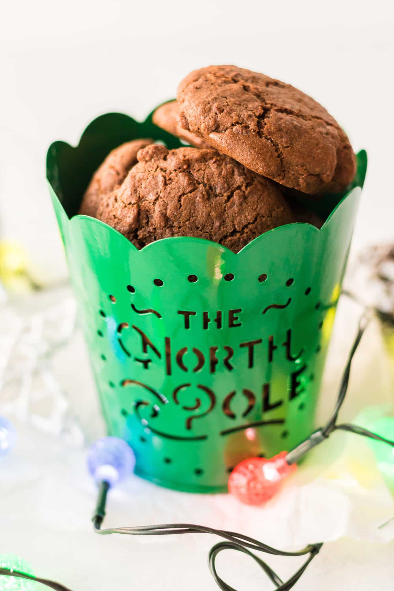 baked molasses cookies in a holiday tin