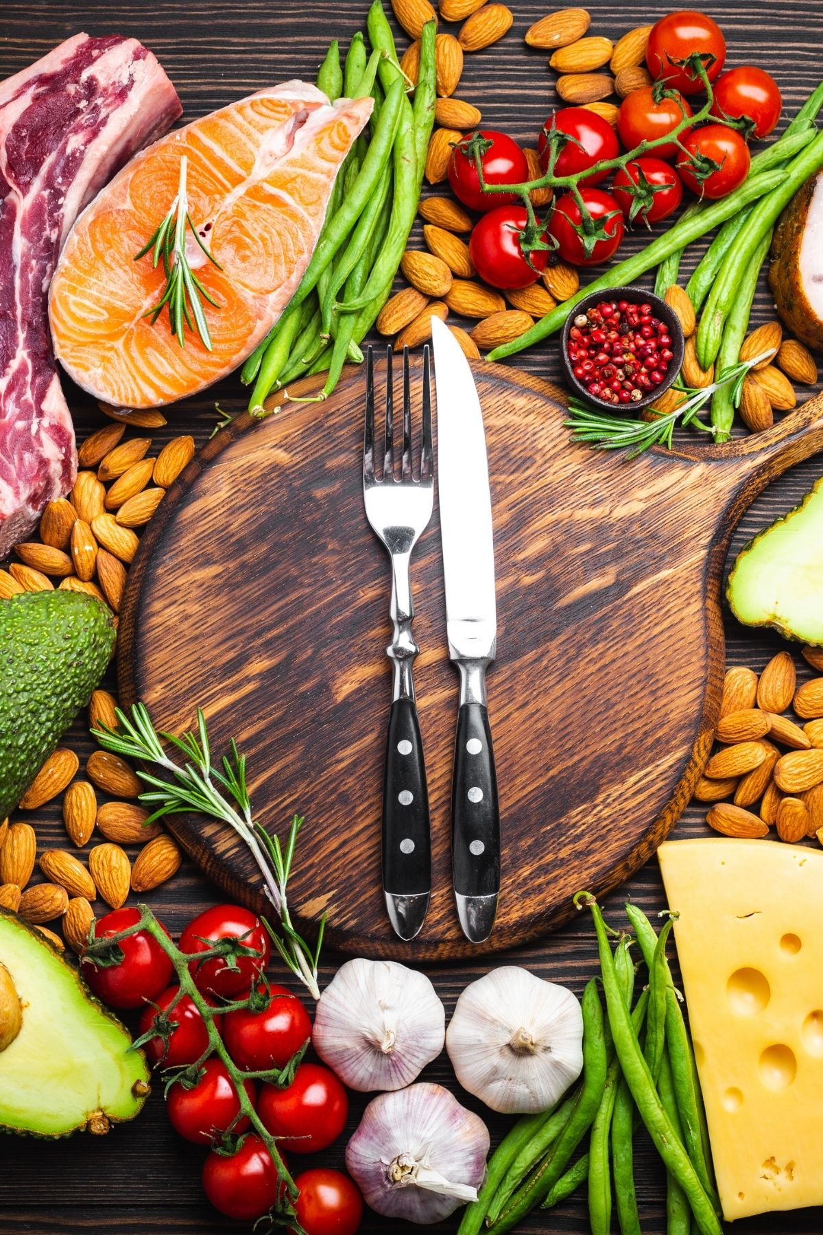 keto diet foods on a table with a fork and knife