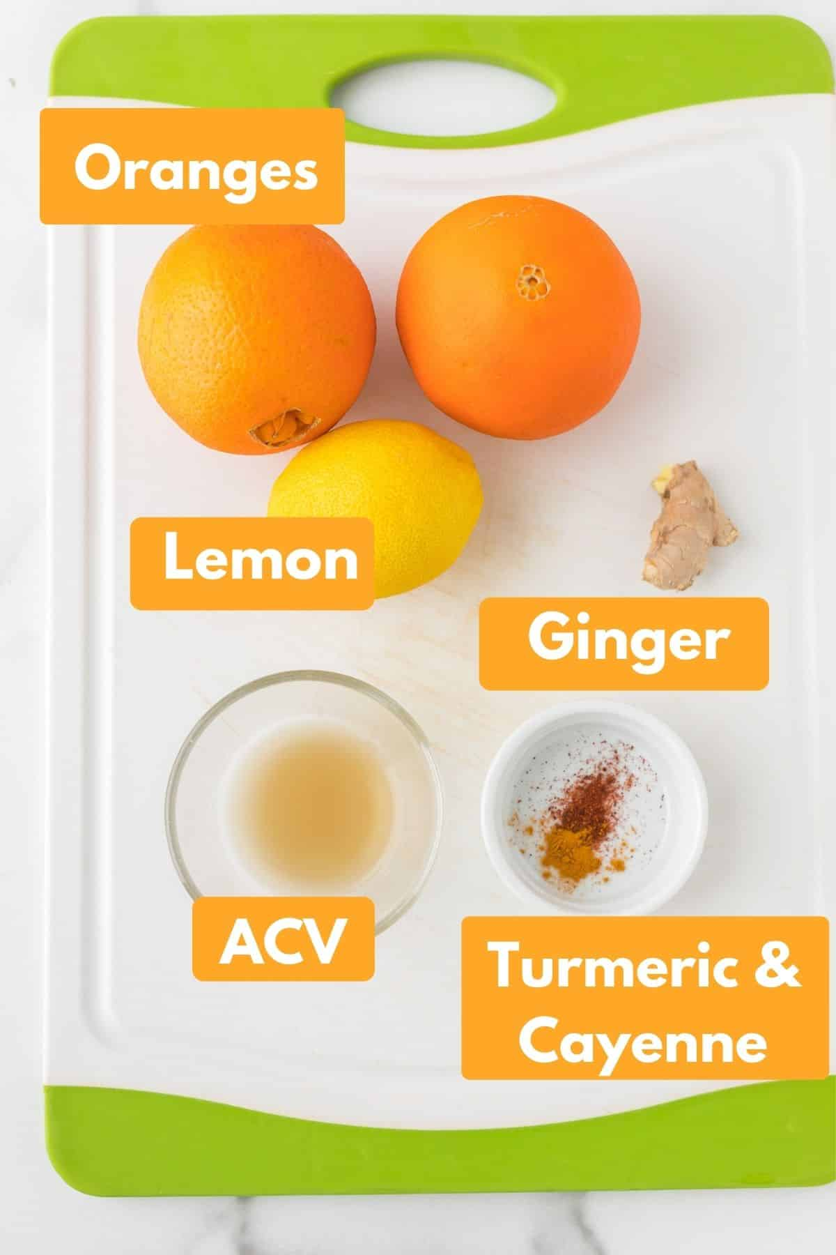 ingredients for ginger citrus immunity shot on a cutting board