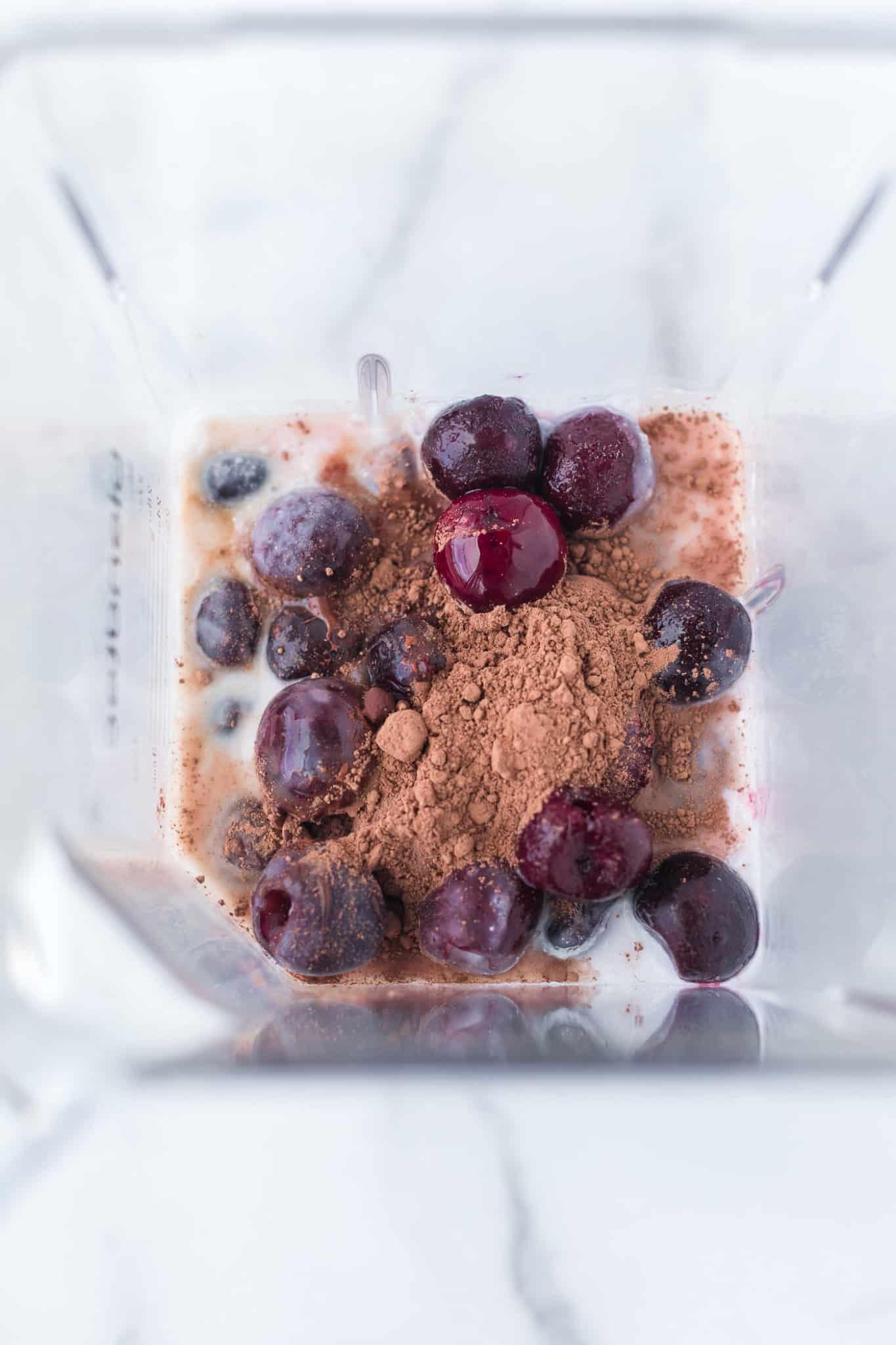 ingredients for cherry smoothie in a blendtec blender