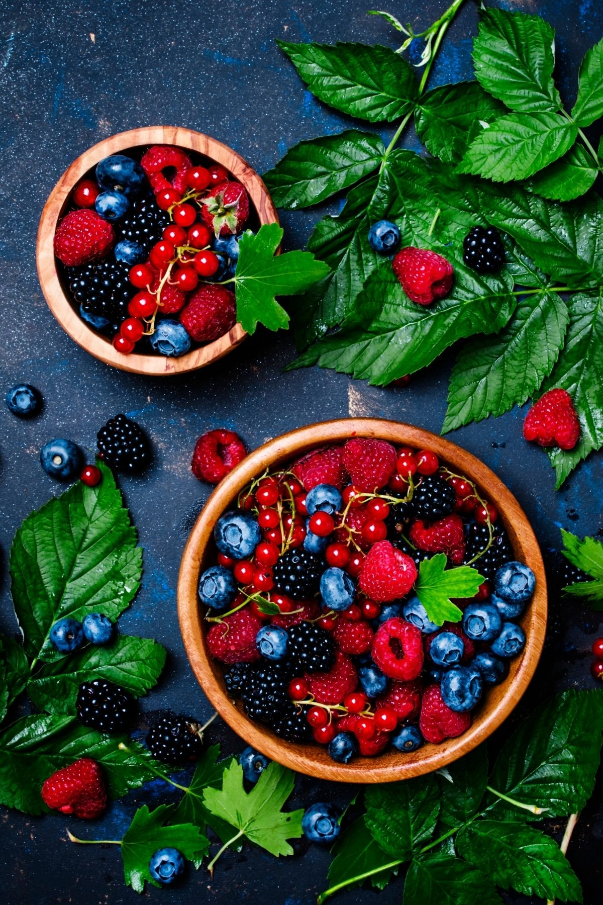 two bowls of berries on a table