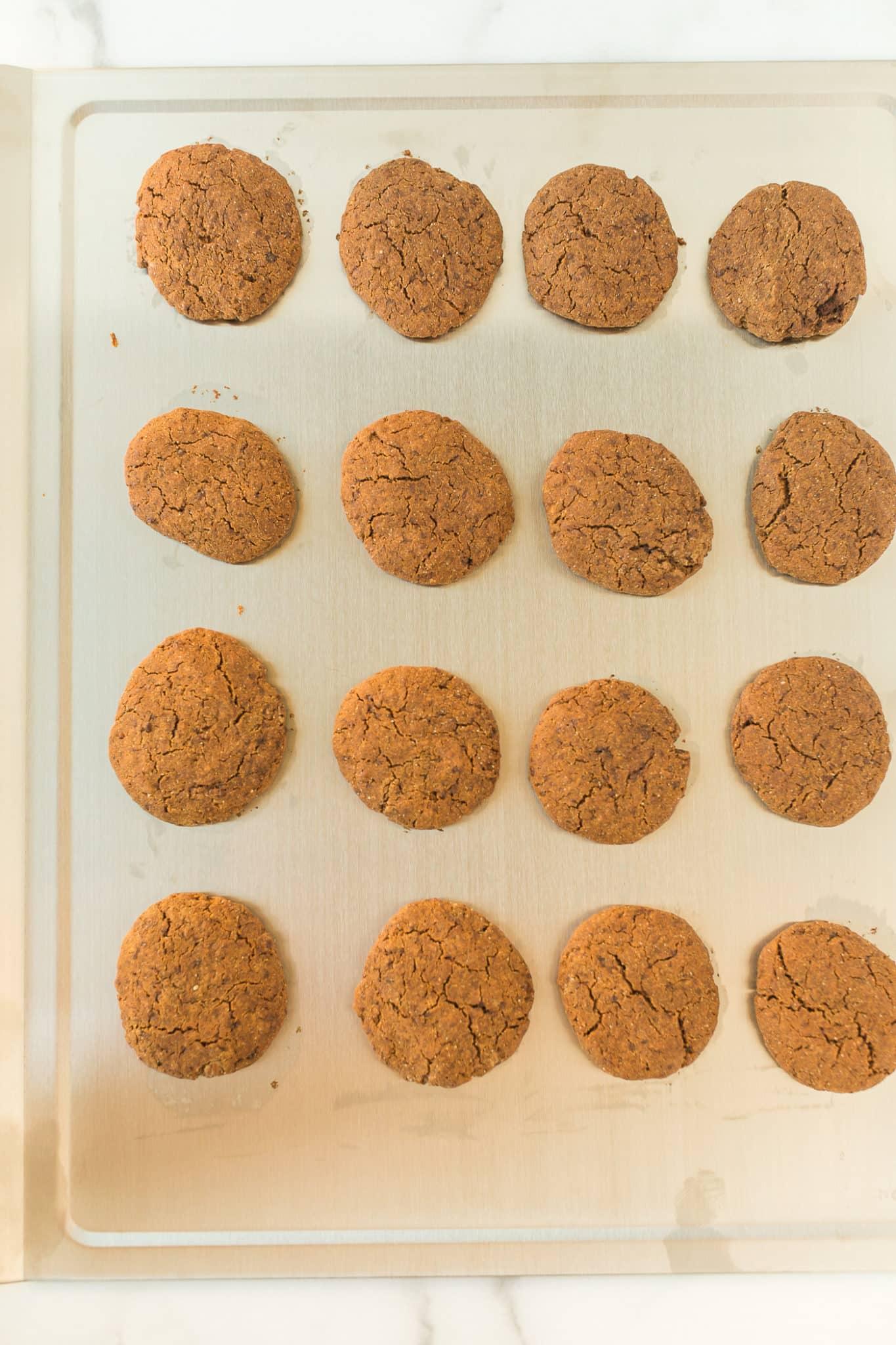 baked molasses cookies on a baking sheet