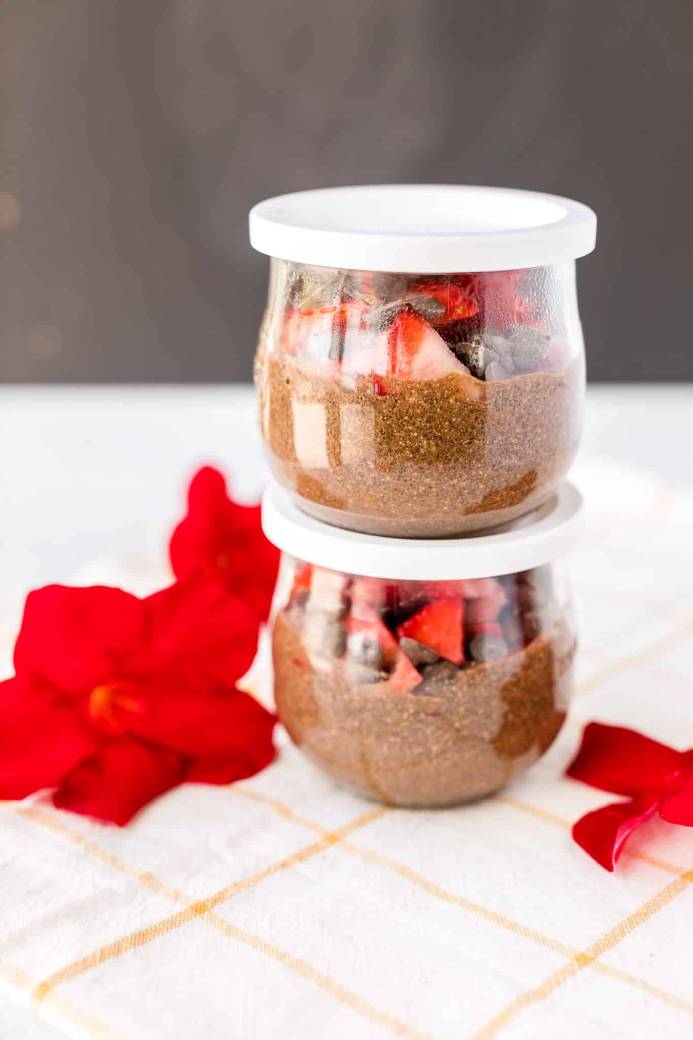 two jars with chocolate chia pudding