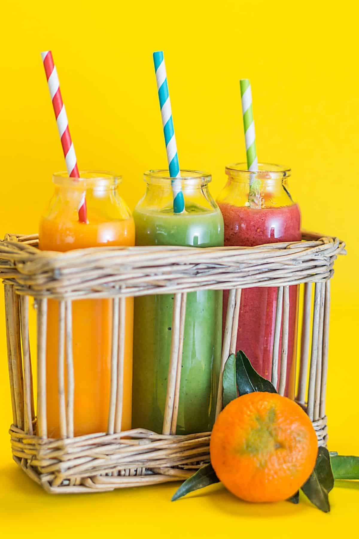 three smoothies with straws ready to drink