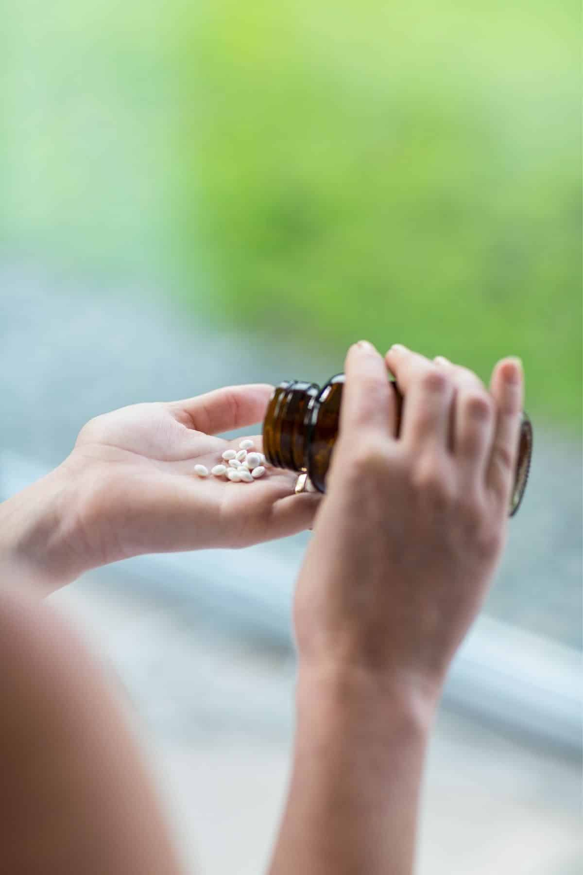 woman pouring pills into her hand