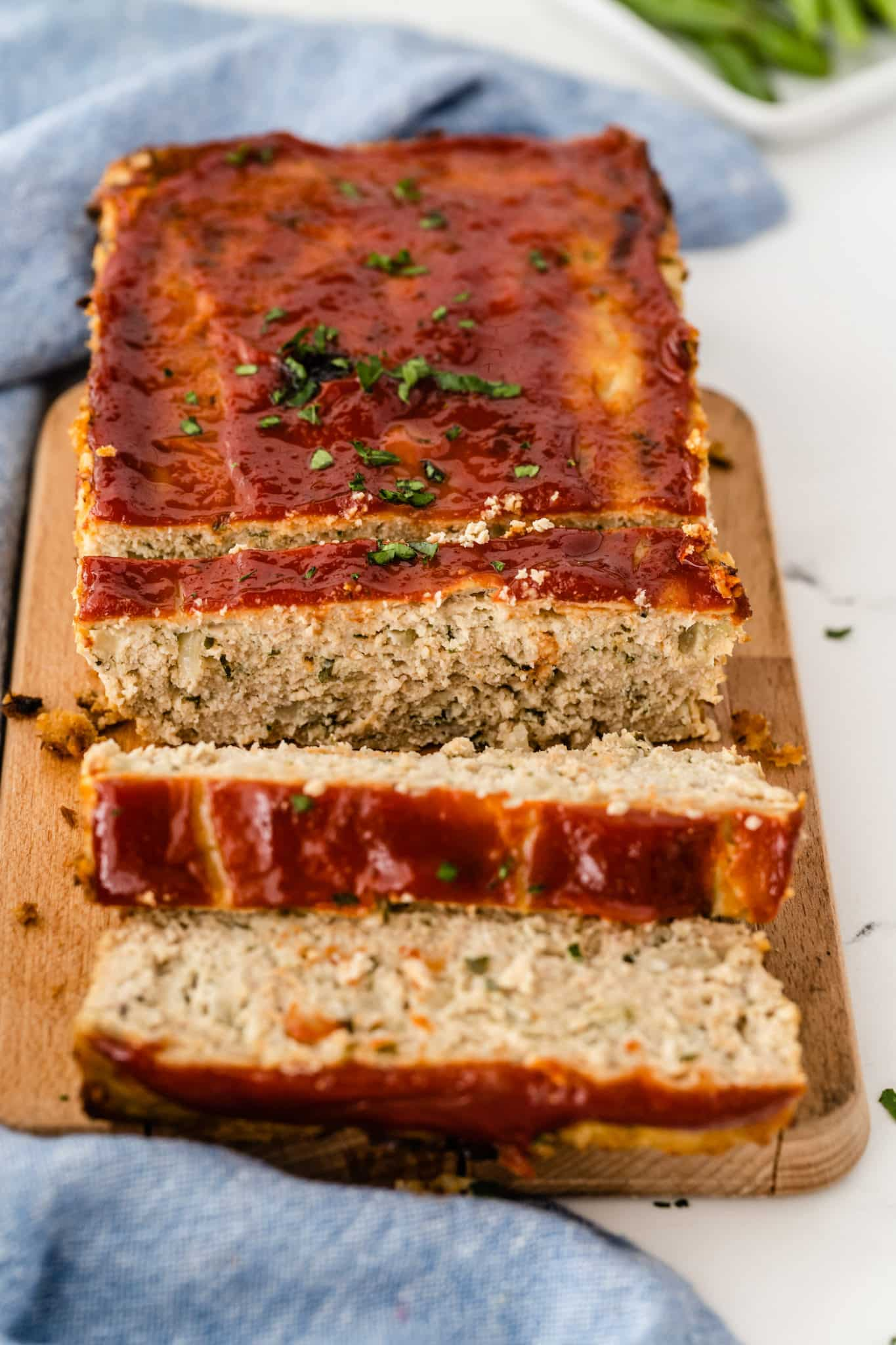 sliced chicken meatloaf with ketchup on top