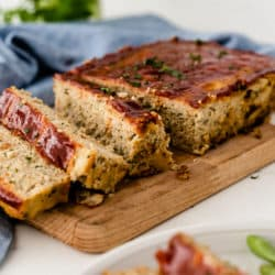 chicken meatloaf cooked and sliced on a cutting board