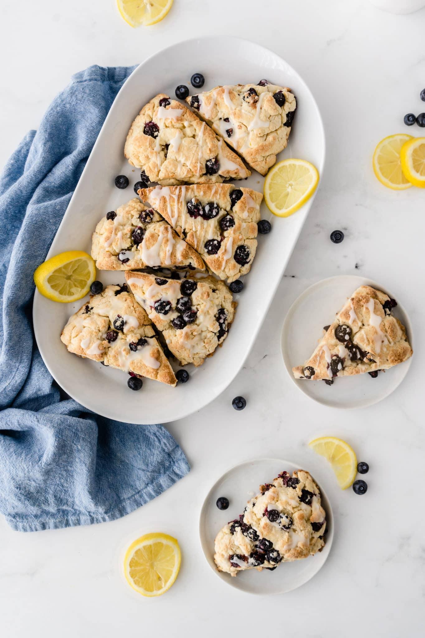 platter of baked gluten-free scones with fresh lemon slices