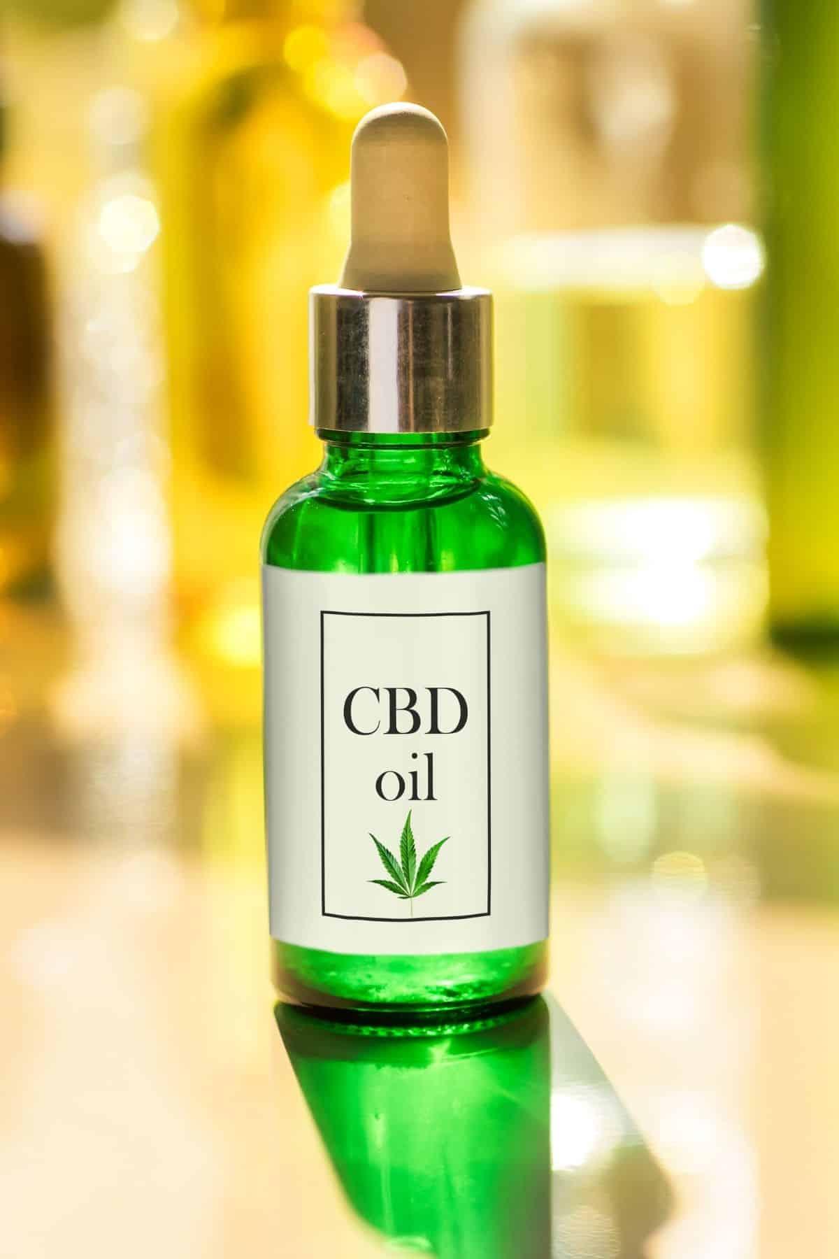 bottle of CBD oil in a green bottle
