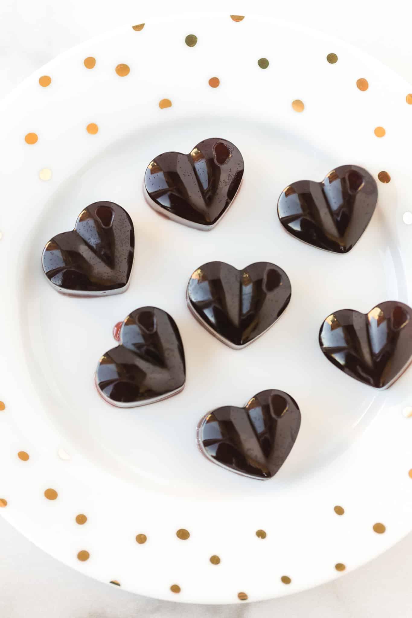 heart shaped homemade cbd gummies on a white plate