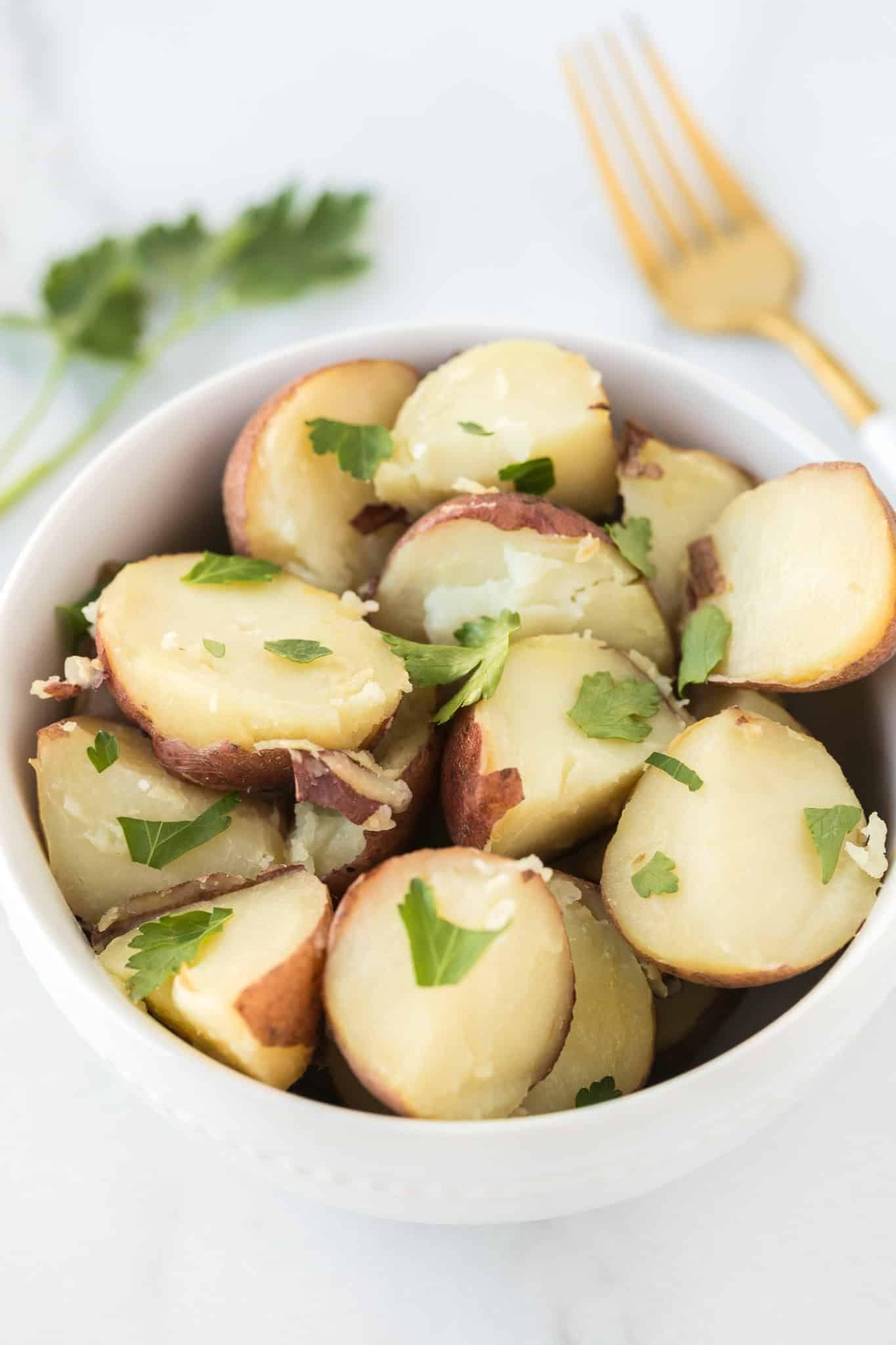 bowl of instant pot boiled potatoes ready to serve