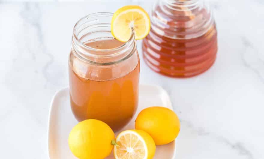photo with a mug of lemon cinnamon water on a table