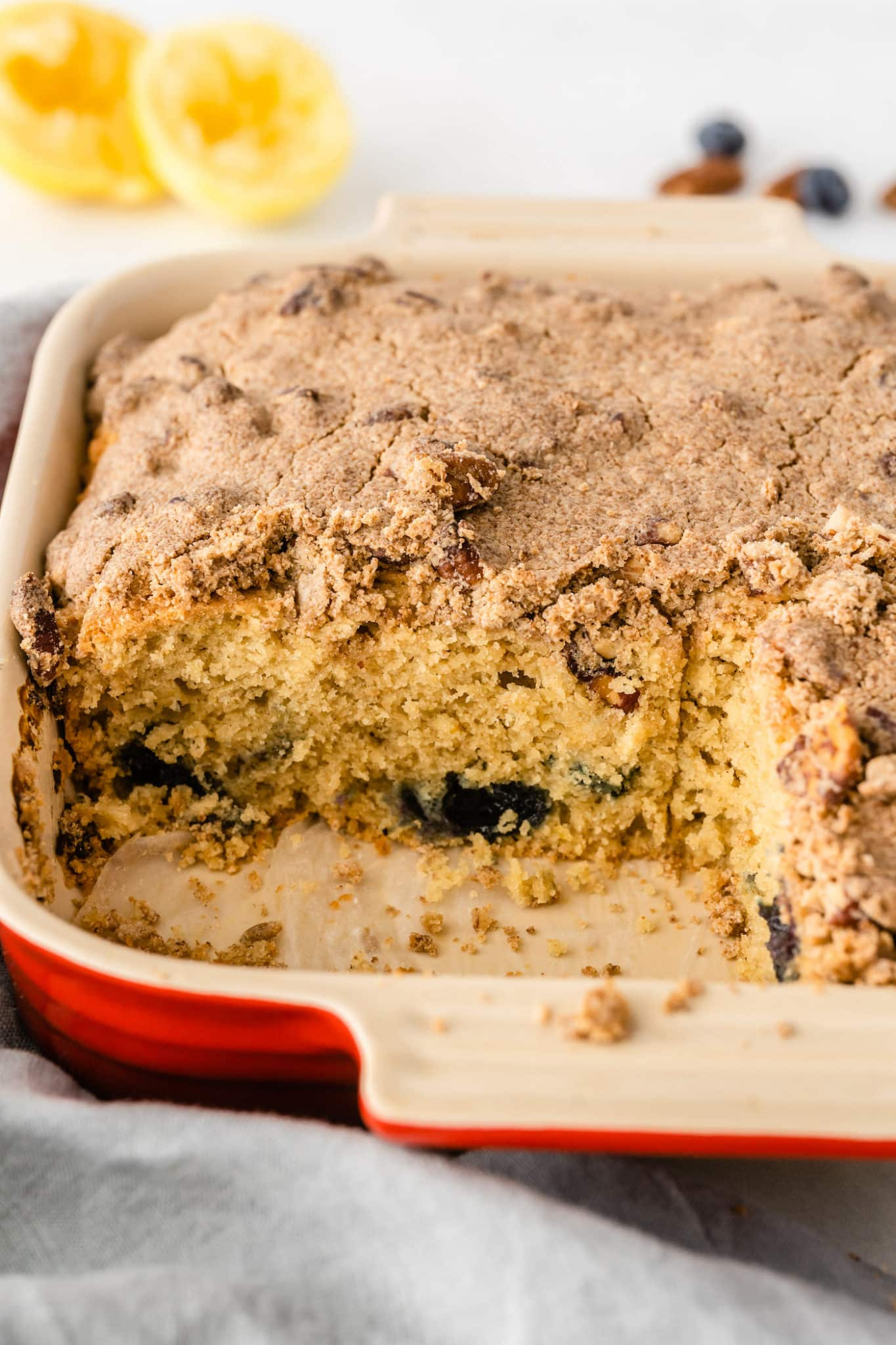 baked gluten free coffee cake with a slice cut out of it