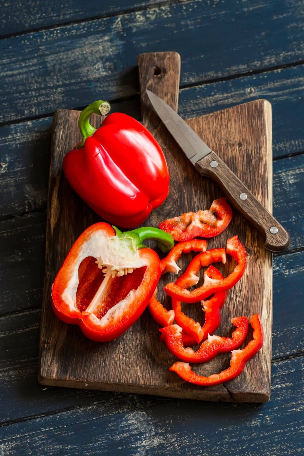 sliced red bell pepper on a cutting board