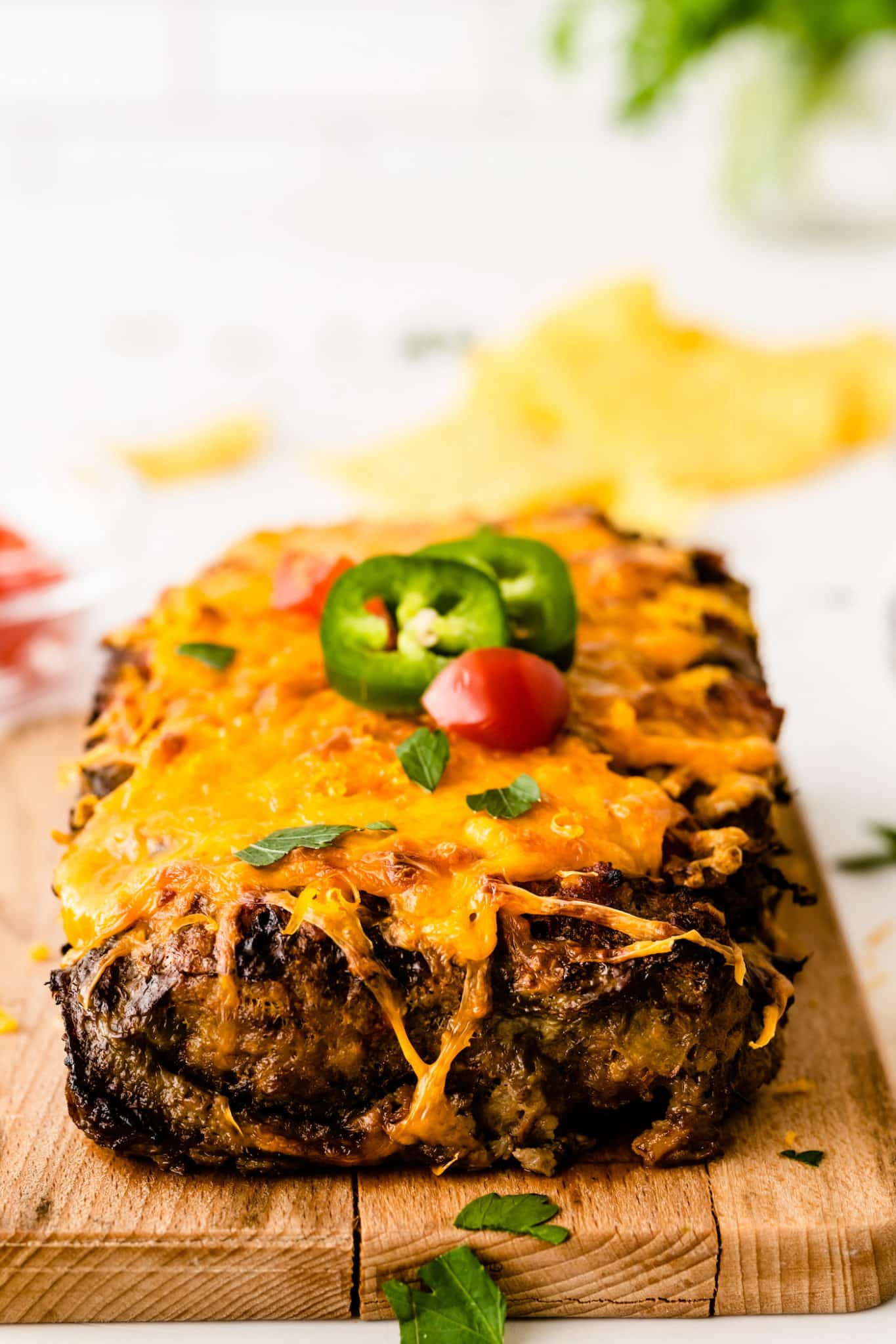 front view of the cooked taco meatloaf with cheese and jalapeño slices on top