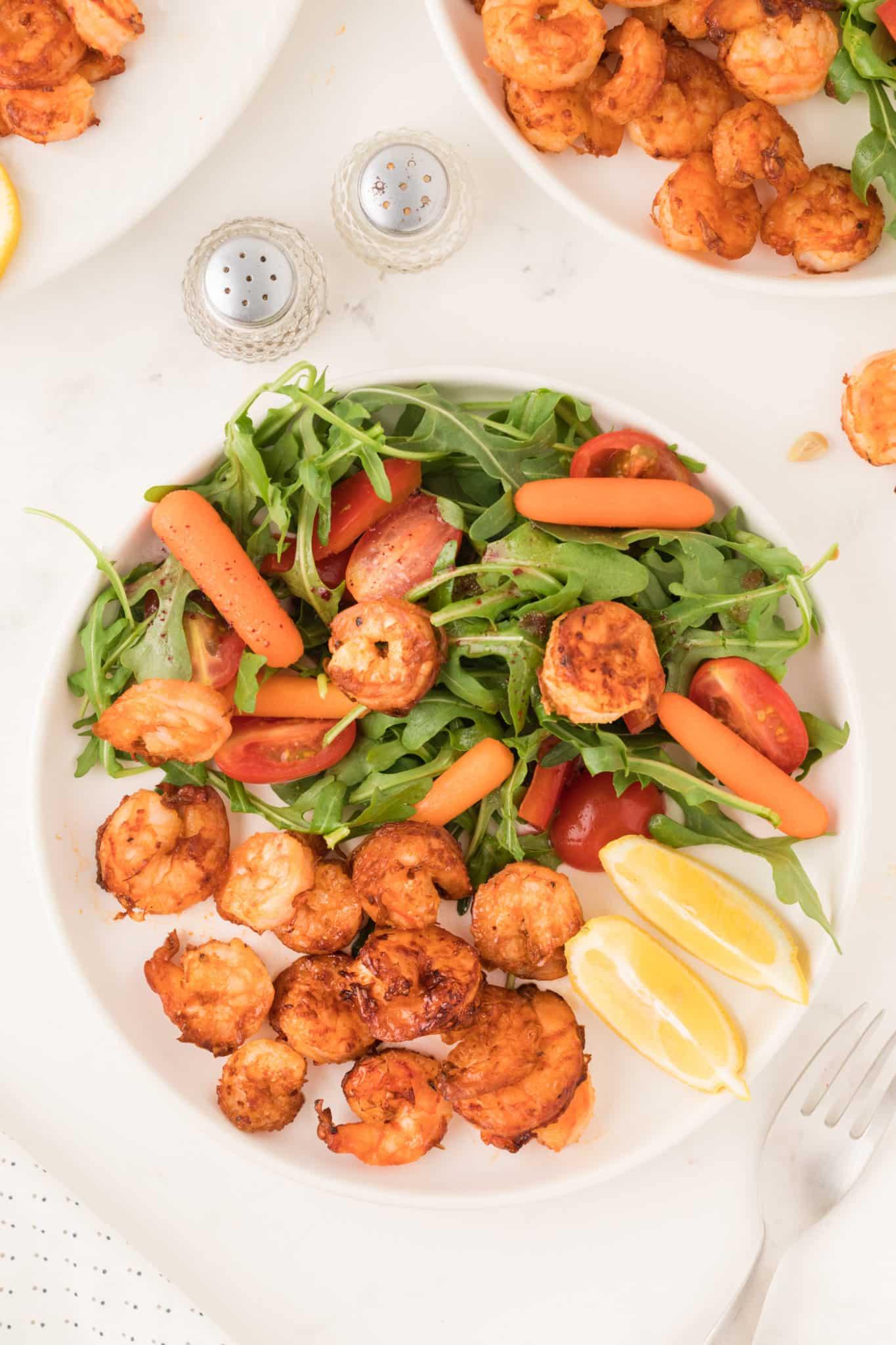 Lemon garlic shrimp with salad on a plate