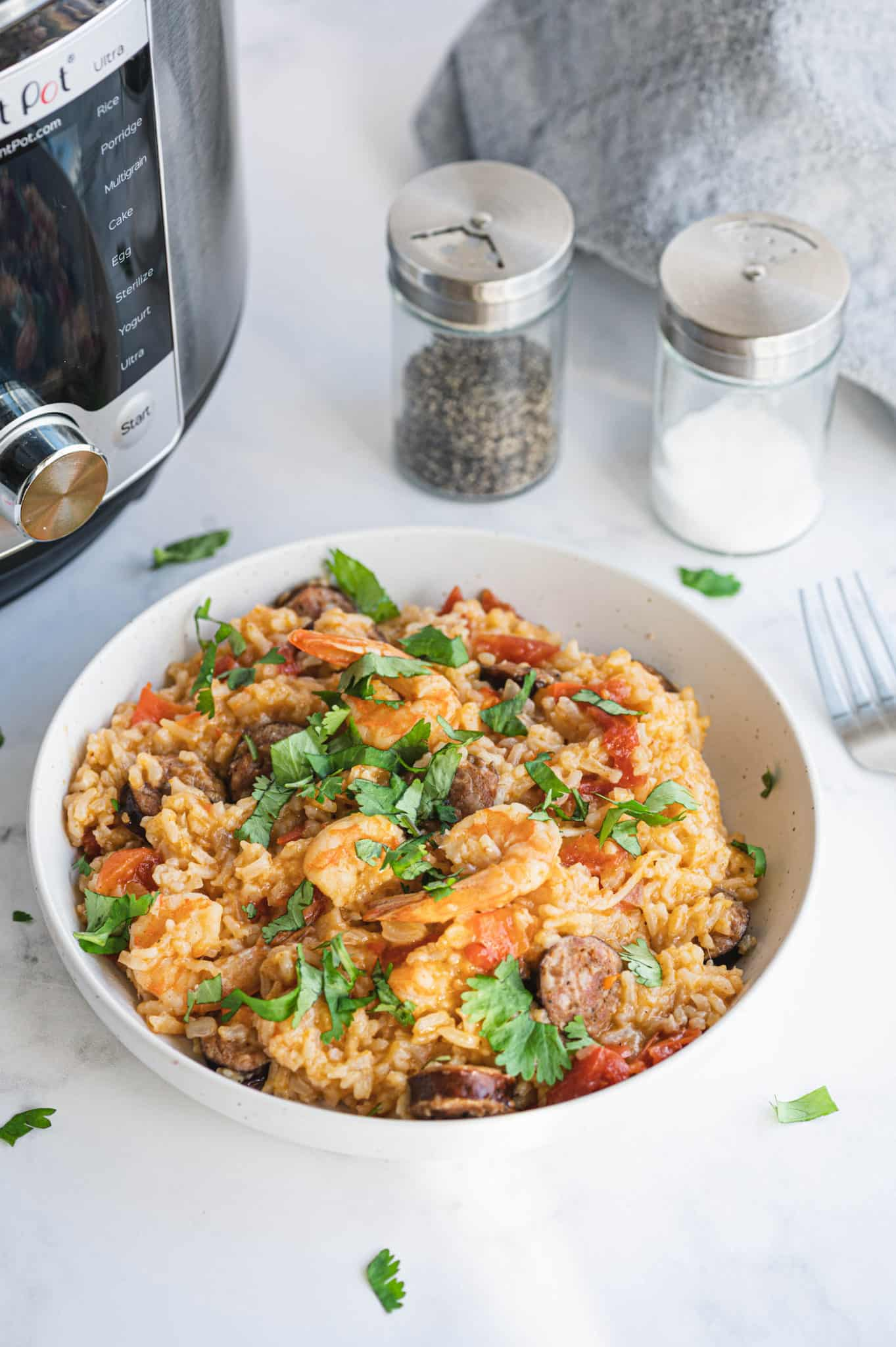 A bowl of jambalaya with shrimp and sausage
