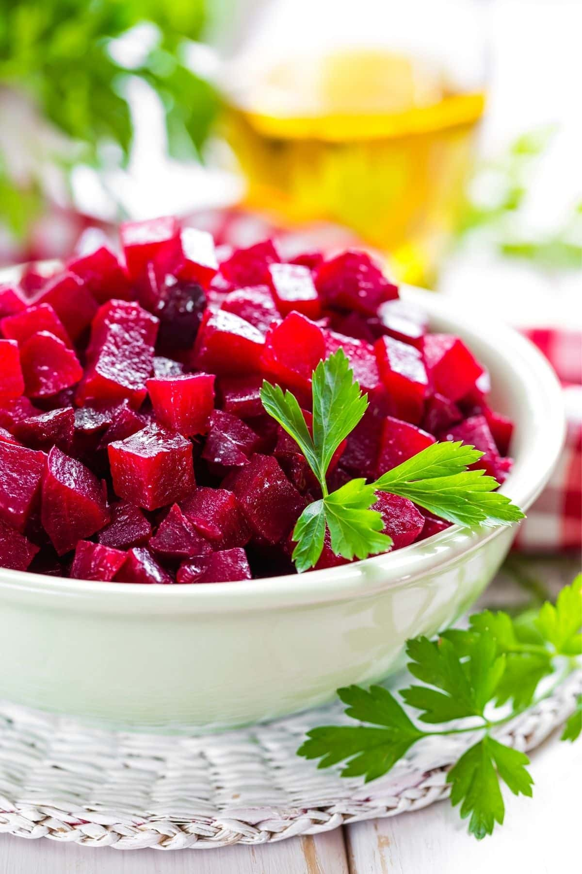 beet salad in a white bowl with olive oil