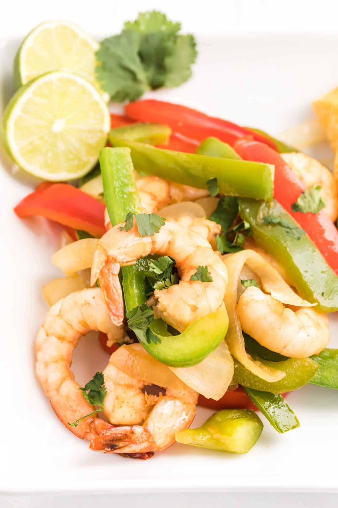 Sautéed shrimp and bell peppers with lime