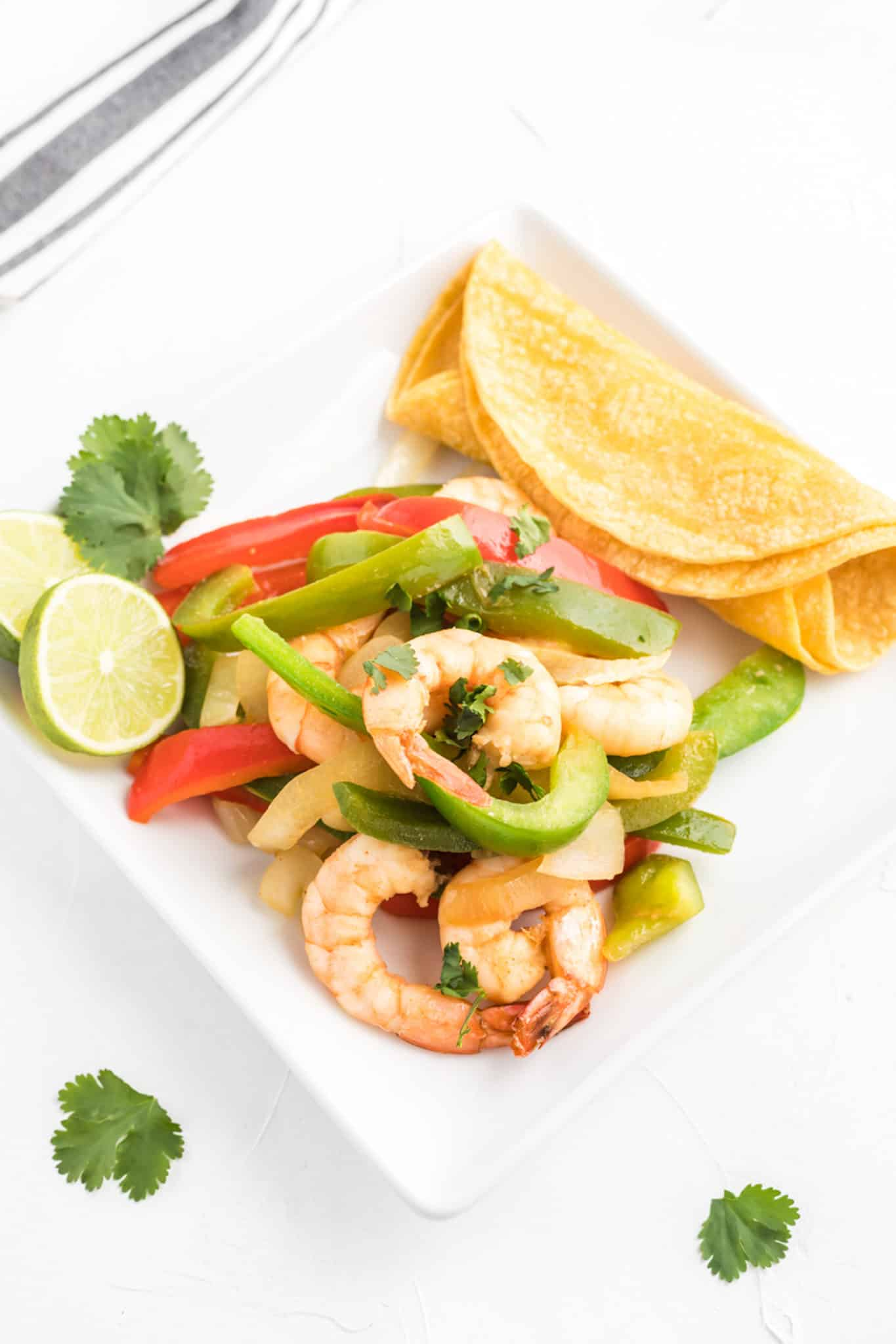 Sautéed shrimp and bell peppers with tortillas