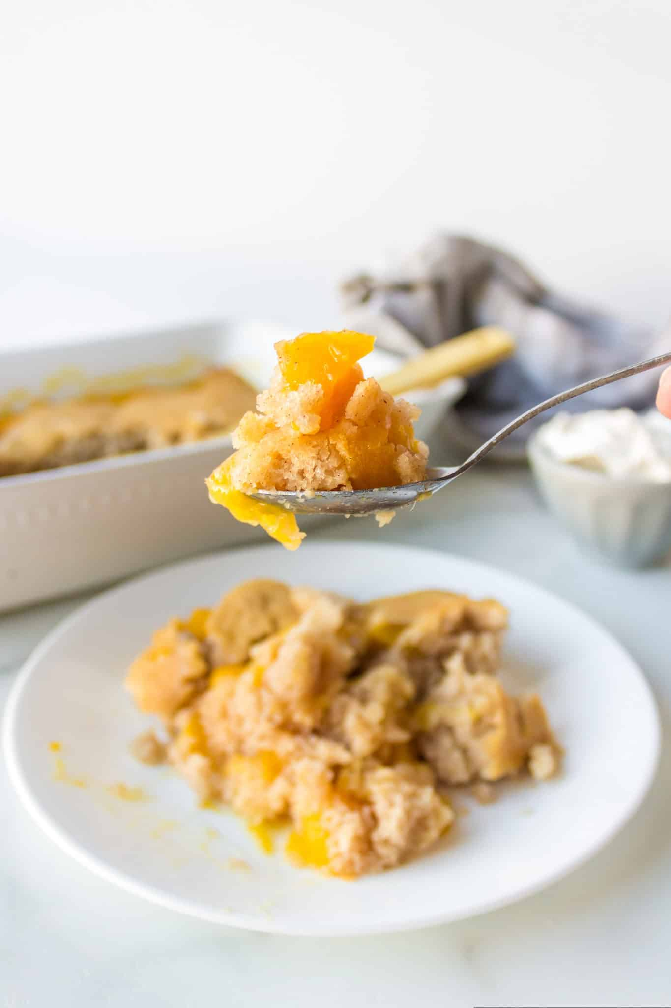 spoonful of peach cobbler ready to eat