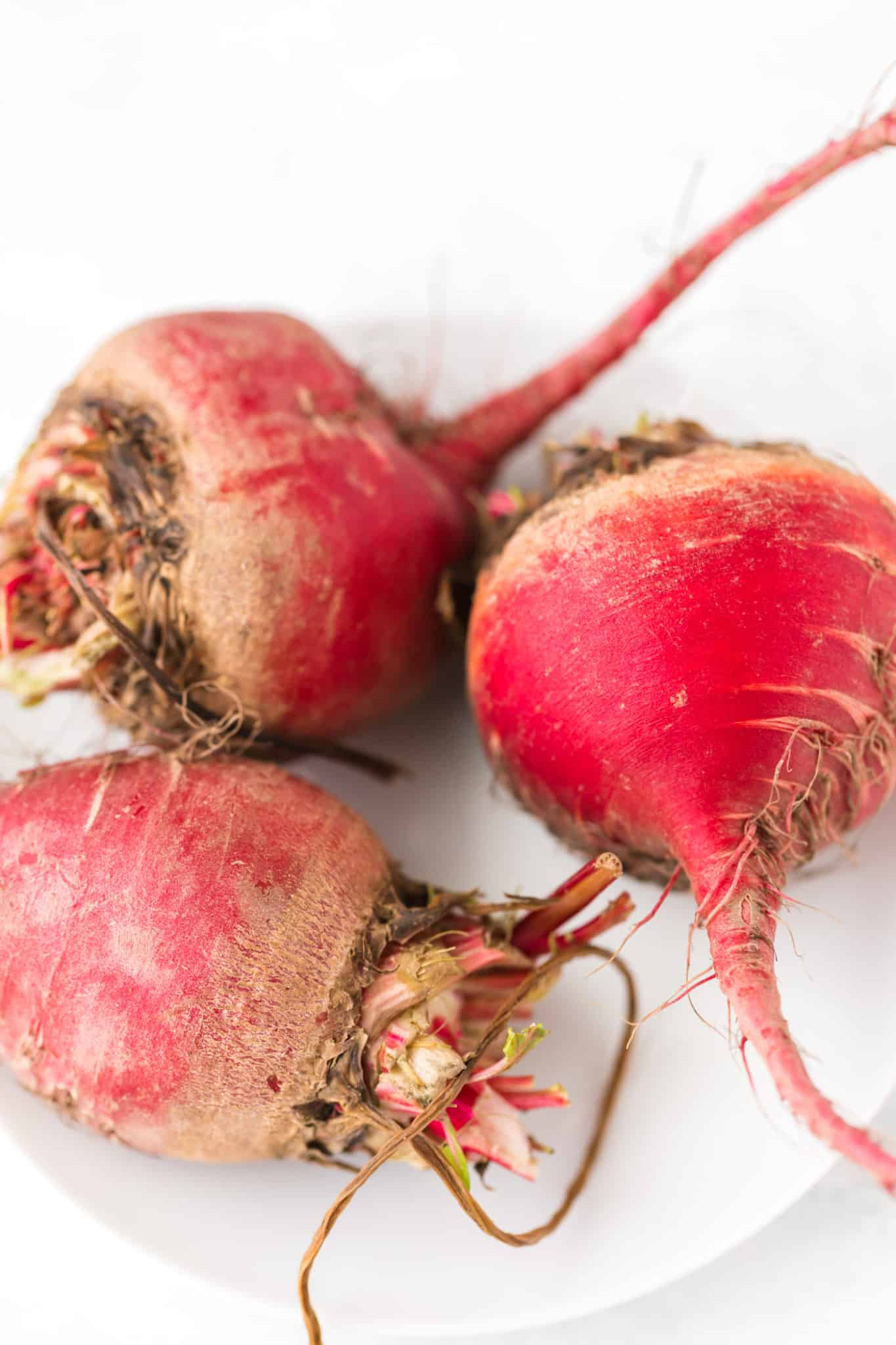 dirty red beets on a plate