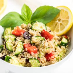A bowl of quinoa salad with vegetables