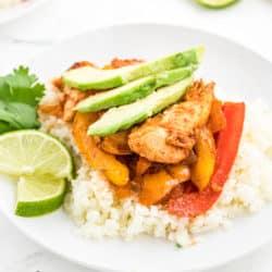 Chicken fajitas on top of cauliflower rice