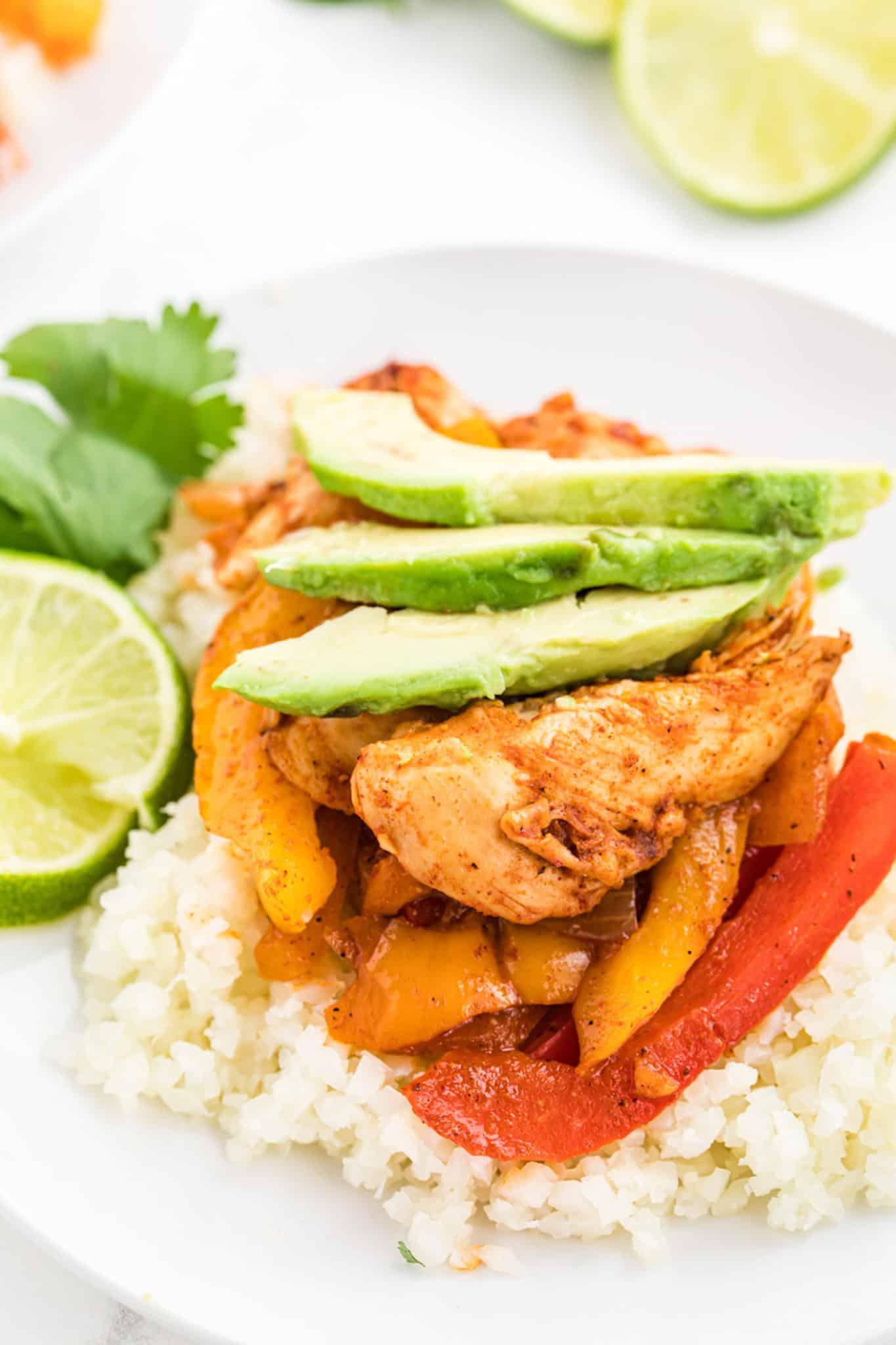 Chicken fajitas over cauliflower rice with avocado
