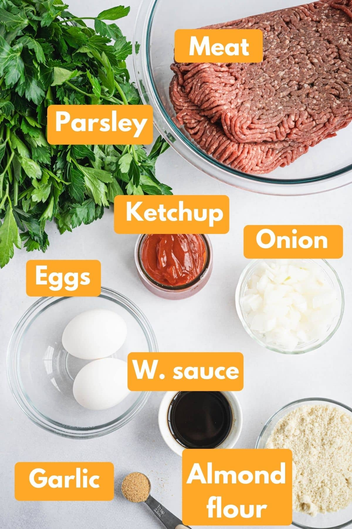 All of the meatloaf ingredients in separate bowls