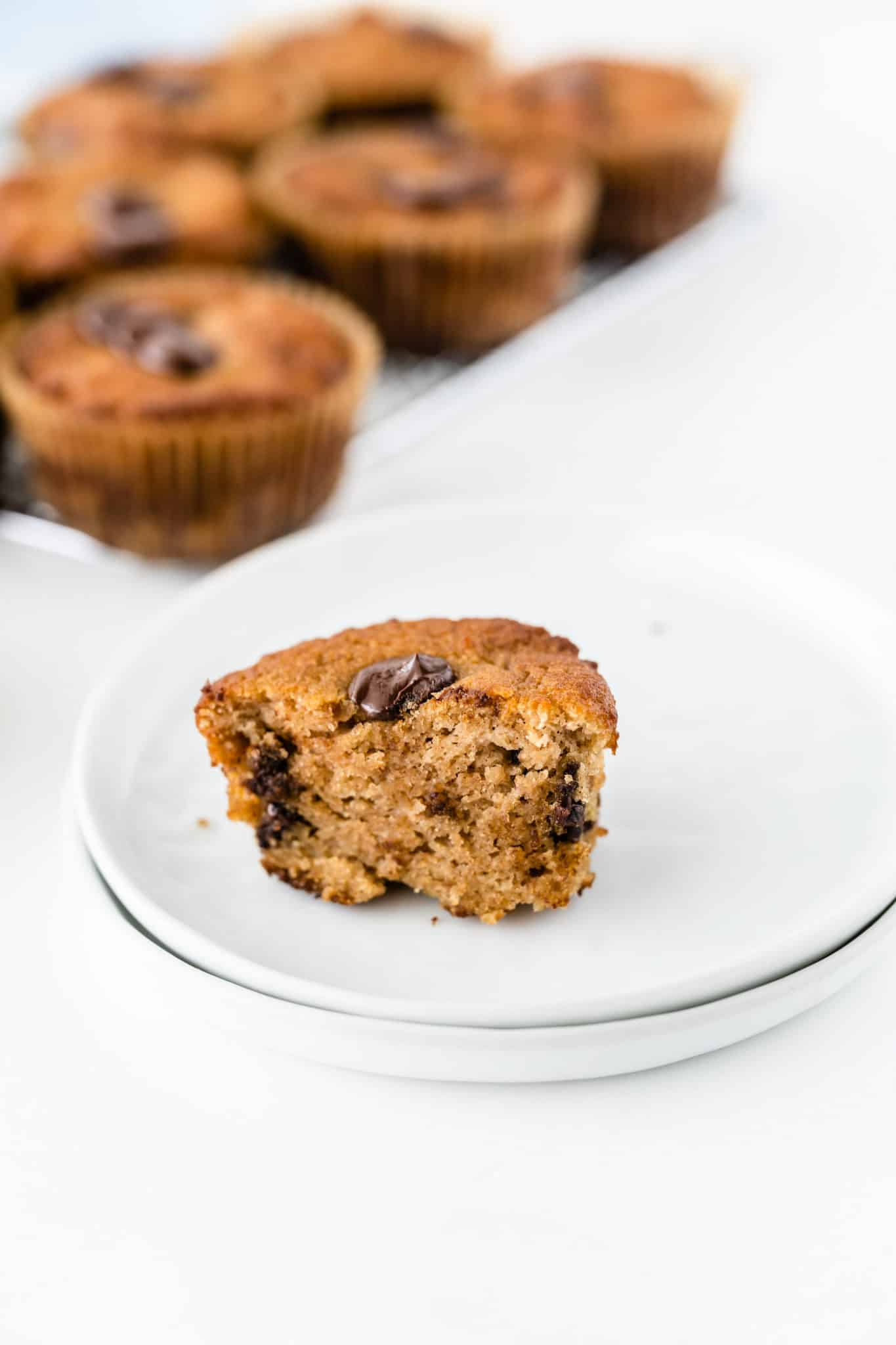 coconut flour chocolate chip muffin with a bite taken out of it