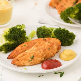 A plate of chicken with broccoli