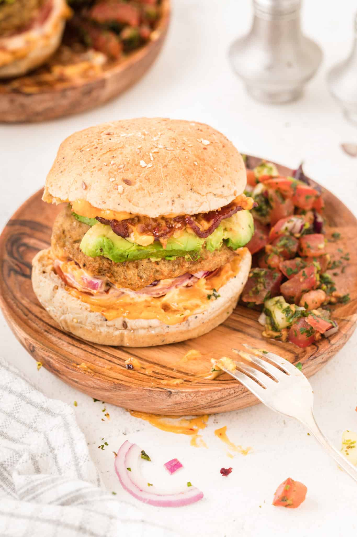 An air fryer turkey burger with avocado and bacon