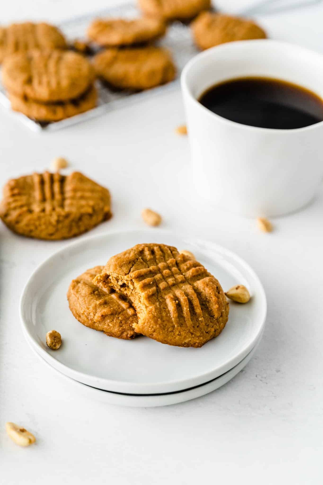 almond flour cookies on a plate with a cup of coffee